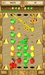 Screenshot von Das hier sind die Yumster! Ziehe die Würmer durch Löcher im Boden und hilf ihnen, Früchte in der richtigen Farbe zu vertilgen!