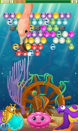 Screenshot von Hilfe der Meduse Maggie die Fischen aus den Blasen zu retten! Schieße und knüpfe die farbigen Blassen zusammen, um sie befreien zu können!