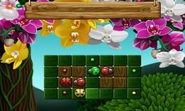 Screenshot von Kombiniere gleiche Marienkäfer und schau zu, wie sie wegfliegen. Es klingt zwar einfach, aber mit den vielen verschiedenen Layouts und der wachsenden Zahl von Farben der Marienkäfer wird das zu einer echten Herausforderung!