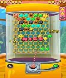 Screenshot von Die kleine Suzie möchte schon wieder neue Süßigkeiten. Hilf ihr, einige aus den Bonbonautomaten zu bekommen.