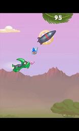 Screenshot von Katapultiere die Dino-Kids in die Luft  wer fliegt weiter? Nutze Power Ups & lass dir von Flug- und Trampolin-Dinos helfen!