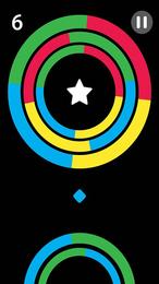Screenshot von Lass den Ball vorsichtig durch das jeweilige Hindernis springen, sobald die Farben übereinstimmen.