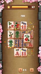 Screenshot von Spiele jetzt Mahjong, das weltweit beliebte Freizeitspiel, in einer wunderbaren Umgebung.