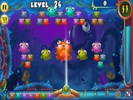 Screenshot von Tippen und ziehen Sie den Winkel zum Ziel, loslassen, um zu schießen. Verbinden Sie 3 oder mehr Fische oder Seesterne von gleicher Farbe und Art, vertikal, horizontal oder diagonal.